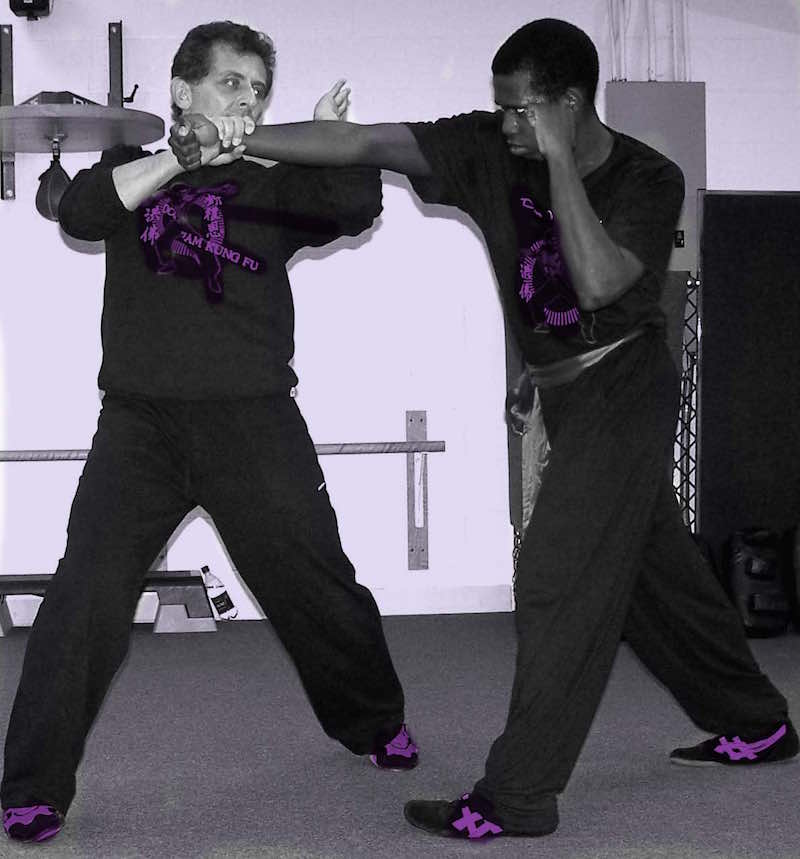 Self Defense Arm Break Technique strike forearm against the elbow joint